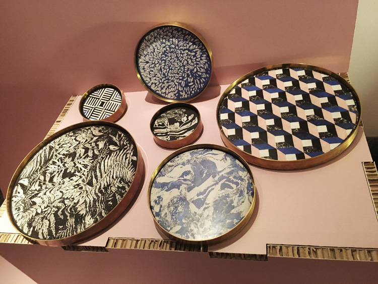 """Pinfold"" are two sets of trays with a brass base and a plate decorated with difficult technique of ""scagliola"", that has been performed in Italy since 16th century (Designer:Studio Blanco/Artisan: Bianco Bianchi)."